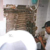 Tommy Blackhorse applying sheetrock.jpg